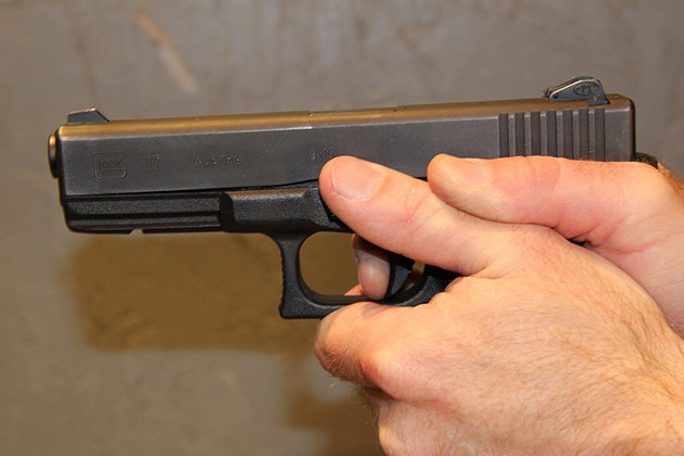 image of hands holding a pistol